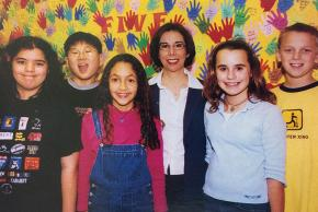Color photograph of Laraine W. Edwards, principal from 2003 to 2010, with students.