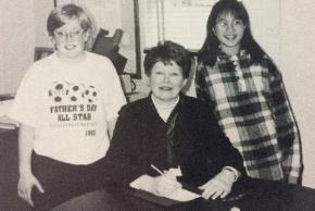 Black and white photograph of Jean Hall, principal from 1993 to 1996, with students.