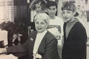 Black and white photograph of Courtney Pelley, principal from 1991 to 1993, with students.