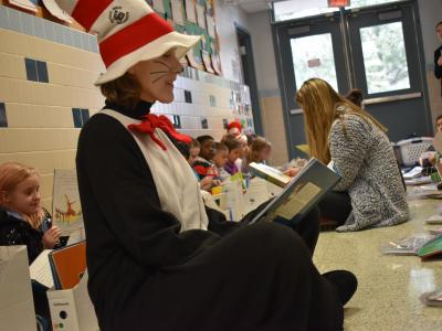 First Graders read in the hal