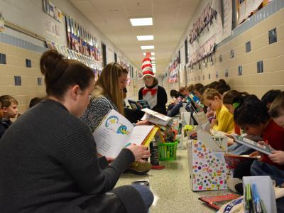 First graders read in the hallway for DEAR to celebrate Read Across America Week!